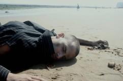 Man-adrift-beach