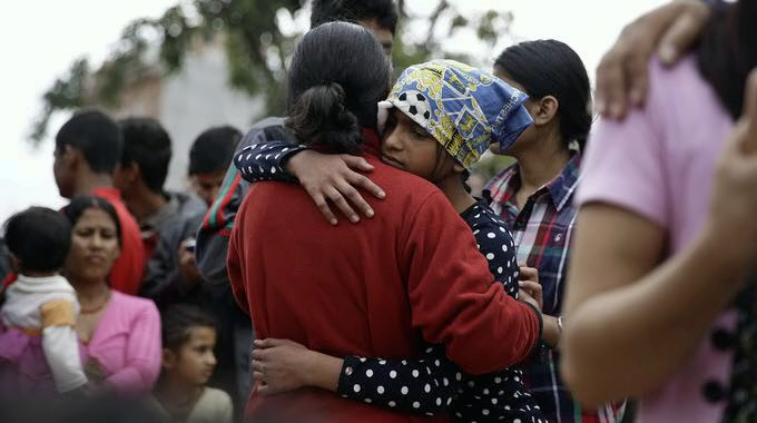 NEPAL-EARTHQUAKE-embrace