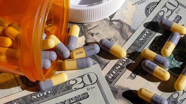 big pharma money and pills