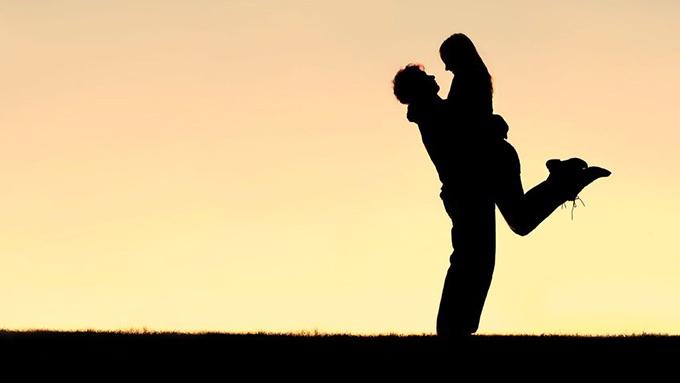 man lifts woman