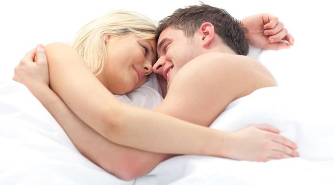 couple cuddle in bed