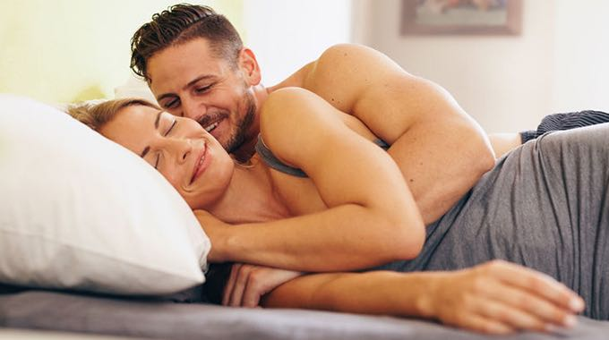 sexy man and woman cuddle