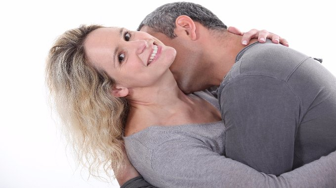 Man kissing woman's neck-compressed