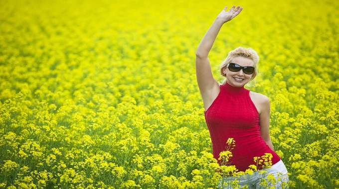 WOMAN IN FIELD HAPPY