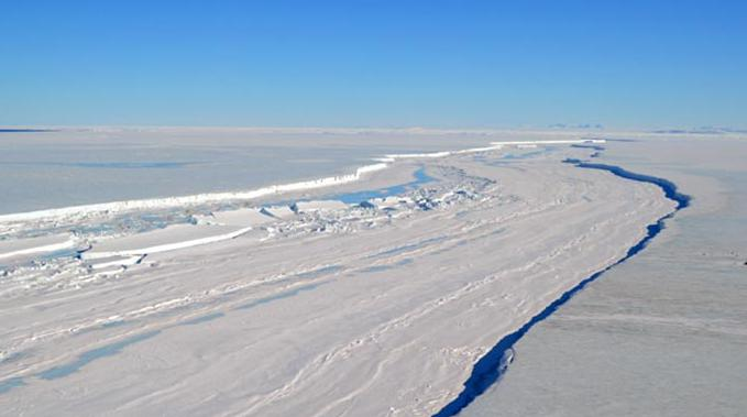 Christine Dow captured this image of the Nansen Ice Shelf via helicopter in December 2015. Photo credit: Christine Dow / NASA Earth Observatory