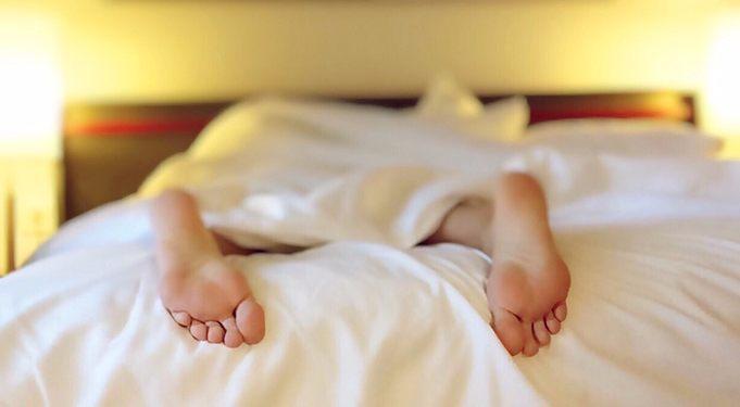 feet in bed sleeping