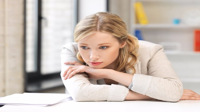 unhappy woman in office-compressed