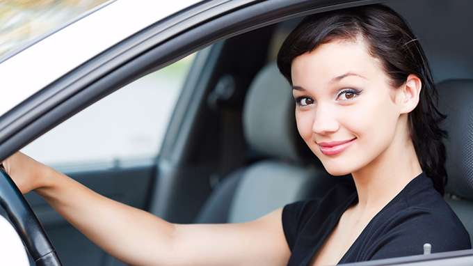 woman drives car