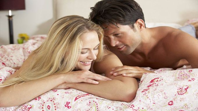 Affectionate couple in bed-compressed
