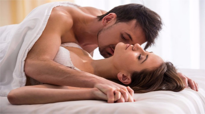 Romantic couple in bed-compressed