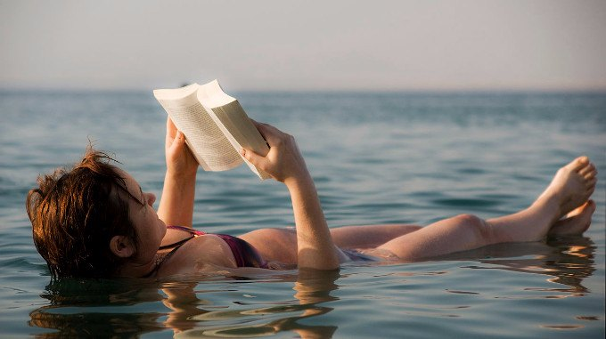 The Dead Sea_-_woman_reading_a_book-compressed