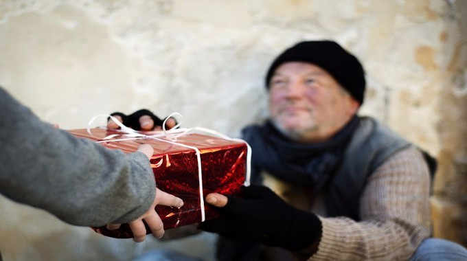 Person giving back to a homeless man-compressed