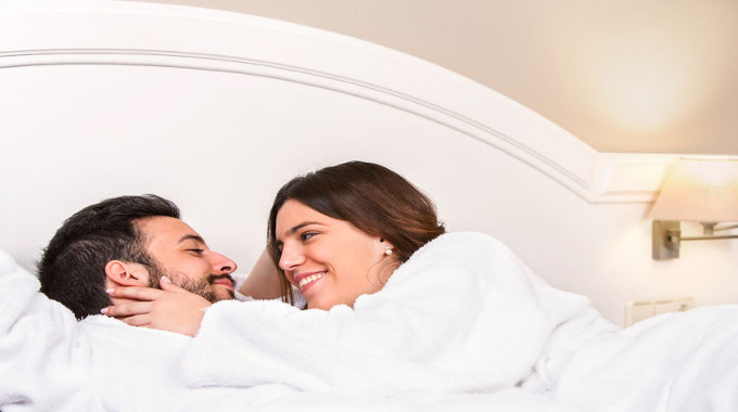 couple enjoying themselves in bed