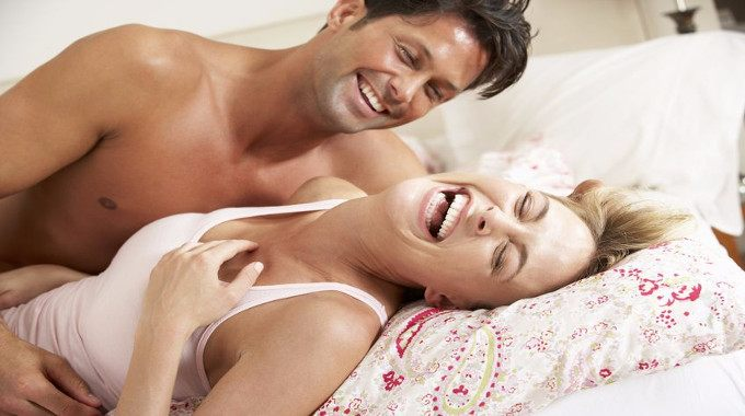 smiling couple in bed-compressed