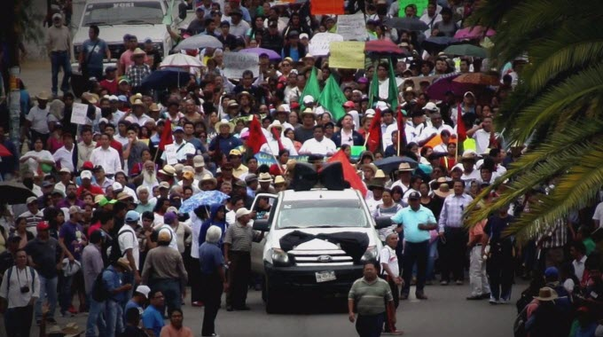 Thousands of teachers protested in southern Mexico on Monday to denounce the deaths of eight people after violent weekend clashes that police blamed on unidentified gunmen.
