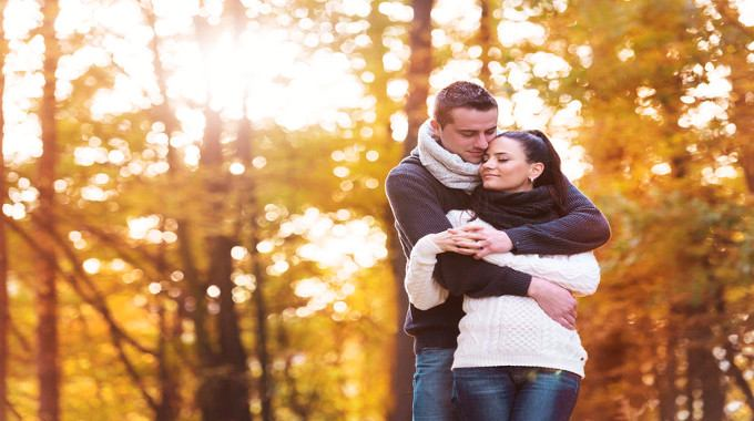 Beautiful couple in love on a walk in autumn forest-compressed