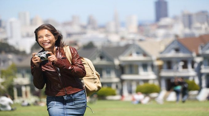 Tourist Young traveler woman holding camera -compressed
