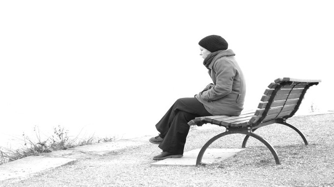 lonely-woman-sitting-on-a-park-bench