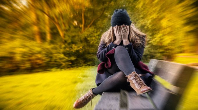 depressed-female-in-autumn-season-compressed