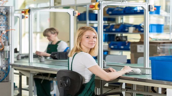 young-woman-working-on-production-line-compressed