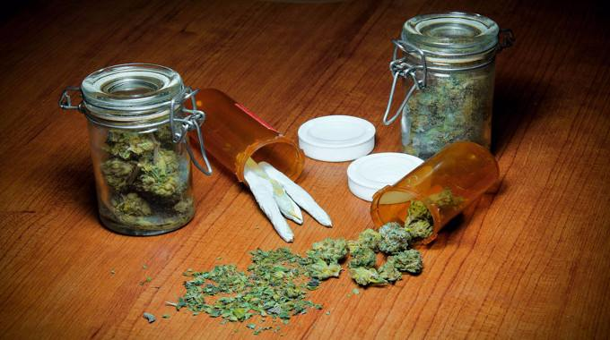 marijuana-in-piles-jars-prescription-bottles-and-rolled-into-joints-compressed