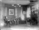 Students in the parlor of an unidentified fraternity house, 1897