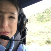 Meredith on helicopter