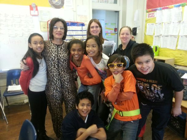 A student group pic with the principal and parent volunteer on tiger dress down day