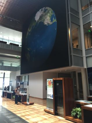 Exhibits and large graphic of NOAA's Pacific Region, in the lobby at the IRC.