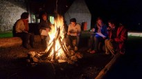 Discussing rewilding in front of our campfire