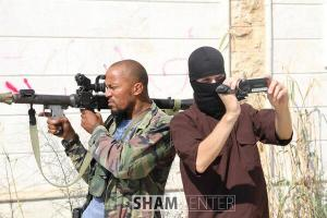 Deso Dogg in Syria, posing with an RPG.