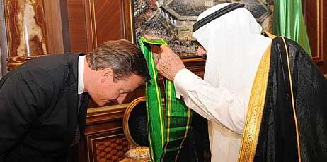 Tory party leader David Cameron and the late Dictator of Saudi Arabia.