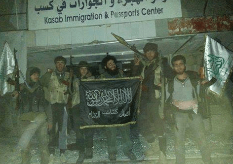 al-Nusra Front fighters pose at Turkish border crossing.