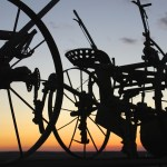 http://www.dreamstime.com/royalty-free-stock-photography-antique-farm-equipment-silhouetted-sunset-sky-image32496577