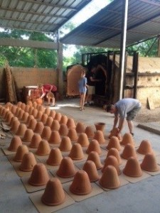 Clay filters being removed from the wood-fired kiln.