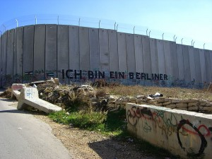 "A section of the barrier -- erected by Israeli officials to prevent the passage of Palestinians -- with graffiti using President John F. Kennedy's famous quote when facing the Berlin Wall, ""Ich bin ein Berliner."" (Photo credit: Marc Venezia)"