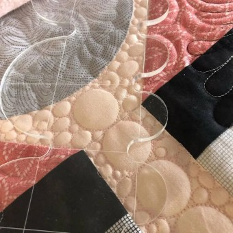 Quilting with clamshell ruler