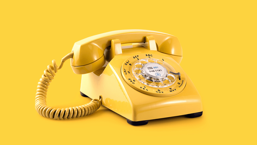 An old analog yellow home phone