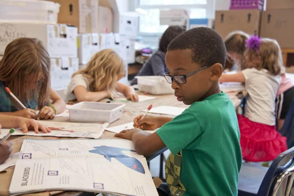 K12, children working through a workbook