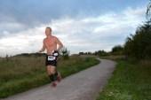 Bare chested runner
