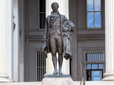US Treasury Department Alexander Hamilton Statue Washington DC James Fraser Statue dedicated 1923. One of the founding fathers of the United States, Alexander Hamilton was the first Secretary of the Treasury in George Washington's cabinet. He was also Chief of Staff to General Washington in the American Revolution. Involved in writing Constitution, also wrote the Federalist Papers.
