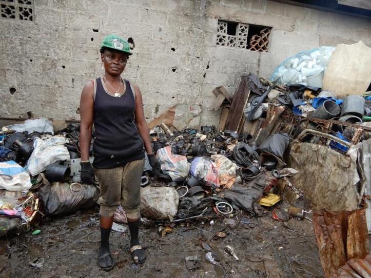 Woman-front-cathodes-mixed-waste-Odo-Iyalaro