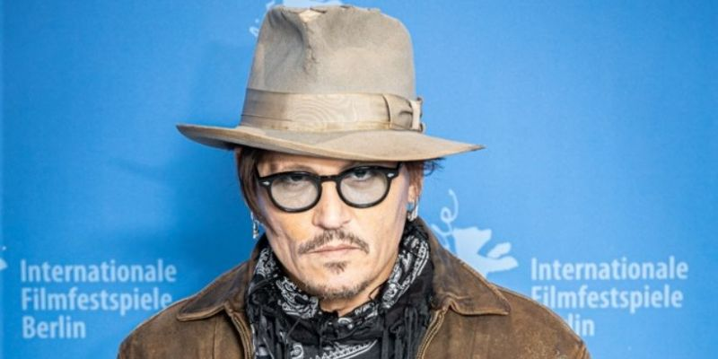 Johnny Depp is warmly welcomed to the festival.  Fans support the actor in a difficult time