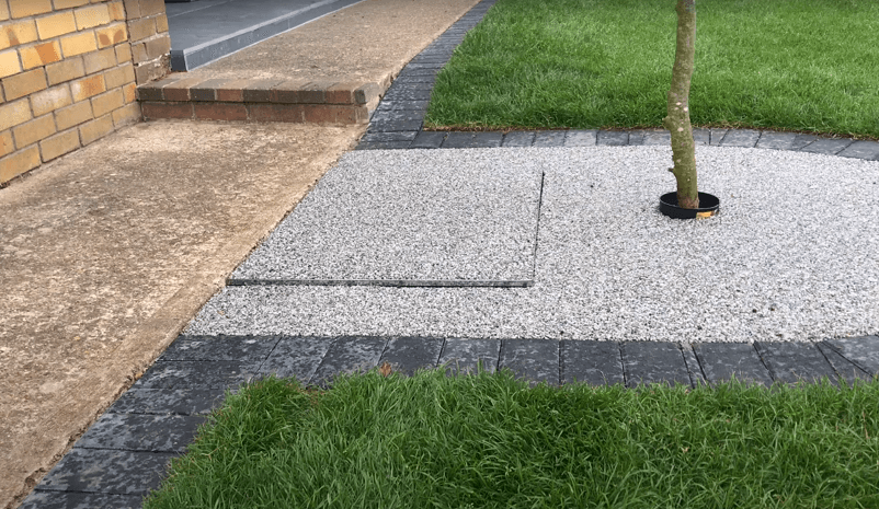 Pavers Eliminating String Trimming and Edging Along Paved Areas & Tree Bed