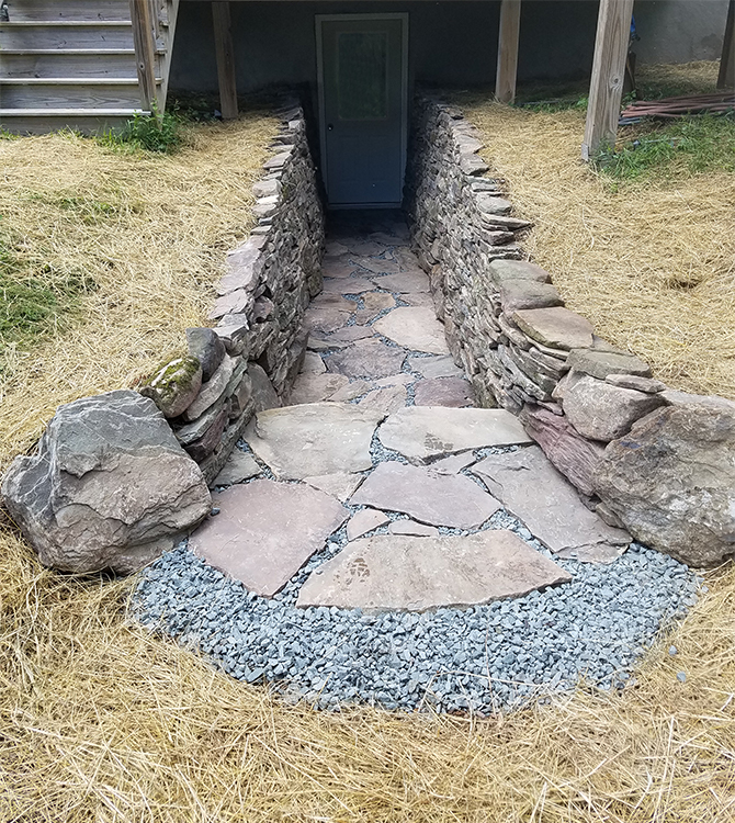 After photo of a stone retaining wall and pathway project