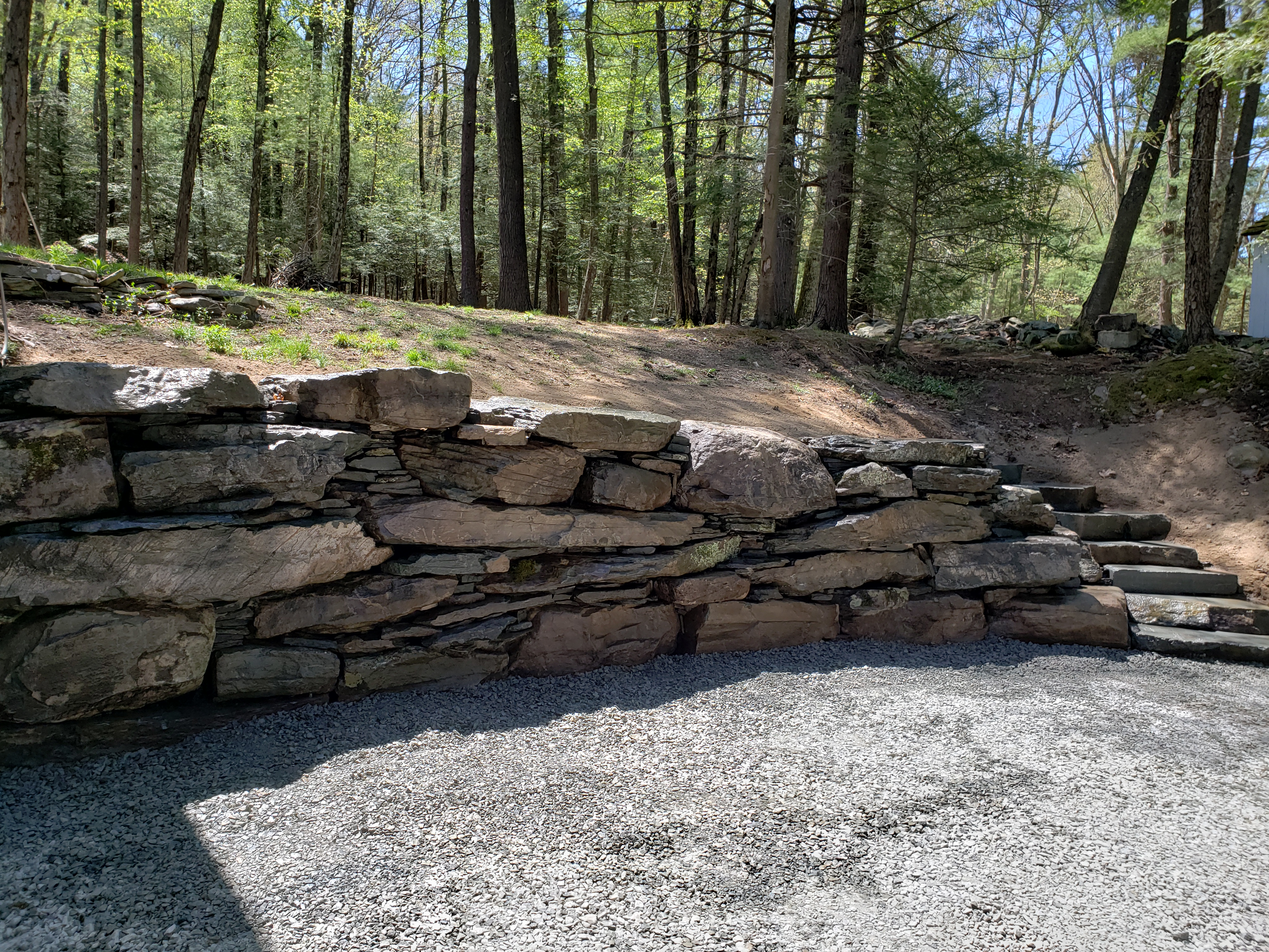 After photo of a fieldstone retaining wall