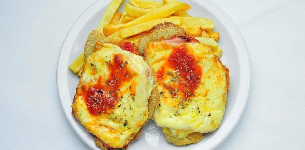 El plato  La milanesa, un clásico que suma nuevas versiones y tiene su homenaje