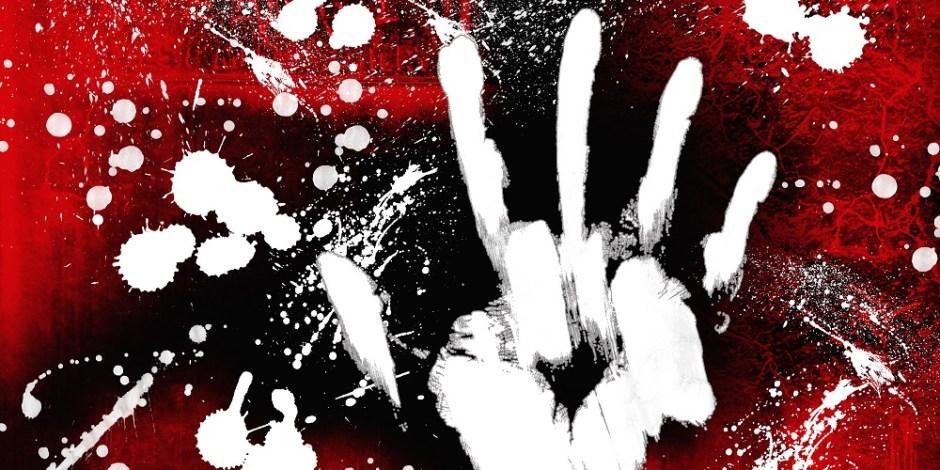 A imagem tem um fundo vermelho, indicando sangue. Sobre a imagem, tem uma impressão de mão em branco. Em volta, várias manchas em branco, indicando pingos de sangue.