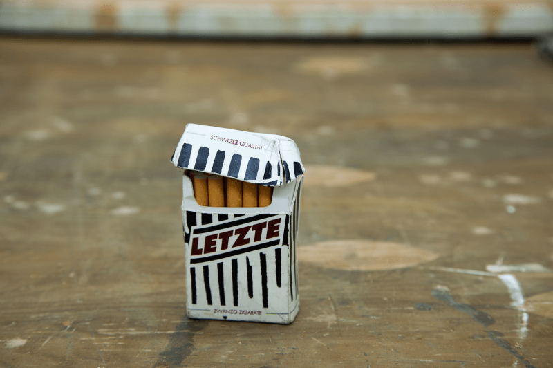 "2 ""Letzte"" Brand Cigarette Pack (2008), silkscreen on paper with cigarettes, 3 1/2 x 2 ⅛ x ¾. Image courtesy of the artist. Photo: Barnett Cohen"