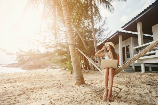 A digital nomad working from the beach